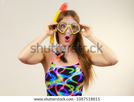 Woman wearing swimsuit with snorkeling mask having fun studio shot, Happy joyful girl dreaming about active summer vacation. Snorkeling swimming concept #1087518815