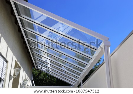 Courtyard canopy with glass Royalty-Free Stock Photo #1087547312