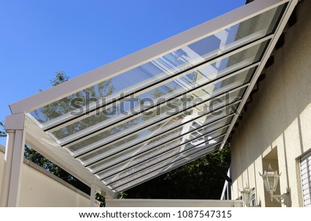 Courtyard canopy with glass Royalty-Free Stock Photo #1087547315