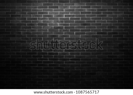 Black wall background The surface of the brick dark jagged. Abstract black wall background #1087565717