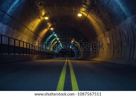 Road tunnel at night #1087567511