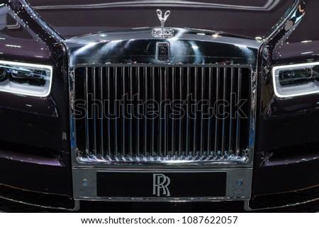Nonthaburi , Thailand - April 7, 2018 : Rolls Royce black color , new design luxury automobile . close up brand logo . front side view car bonnet .   #1087622057