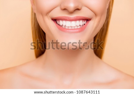 Close up cropped half face portrait of attractive, nude, natural, perfect, ideal girl with healthy white teeth isolated on beige background, perfection, wellness, wellbeing, restoration concept #1087643111
