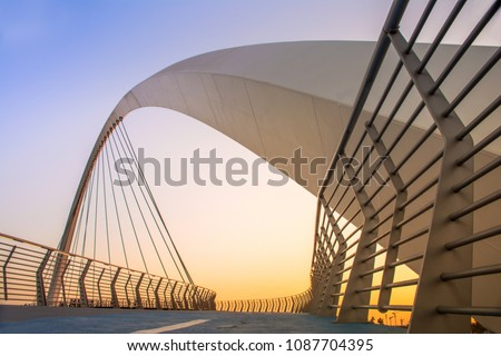 Dubai Water Canal Bridge New Attraction of Dubai City, place to visit in dubai, tourist destination of UAE, beautiful sunset, modern architecture #1087704395