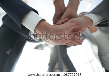 business people folding their hands together. #1087709015