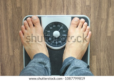 Male on the weight scale for check weight, Diet concept #1087799819
