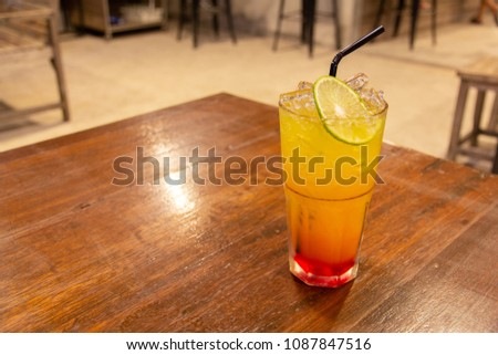 Refreshing summer drink on a wooden table. #1087847516