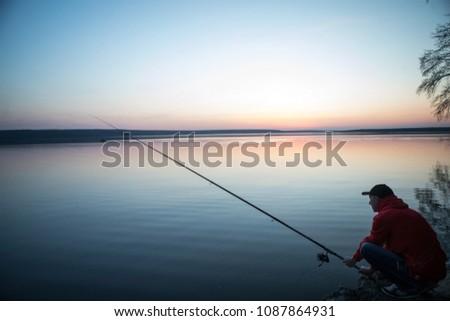 Fishing rod lake fisherman caucasian men sport summer lure sunset water outdoor suinset pond lake river fish #1087864931