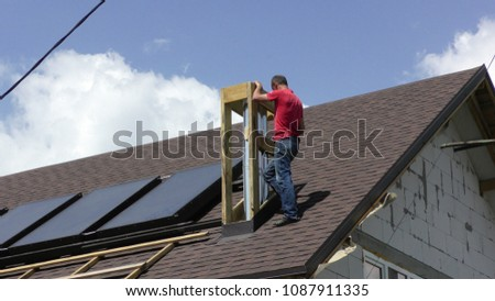 The man is building a chimney Construction and insulation of the roof chimney #1087911335