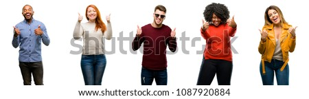 Group of cool people, woman and man smiling broadly showing thumbs up gesture to camera, expression of like and approval #1087920884