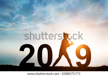 Silhouette of Softball Player in 2019 text for Happy New year Concept