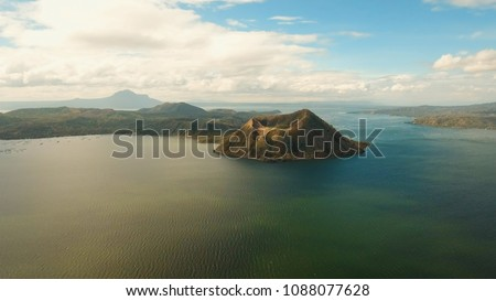 Aerial view Taal Volcano on Luzon Island North of Manila in Philippines. Volcano with a crater on an island in the middle of a lake. Luzon, Philippines. Travel concept. #1088077628