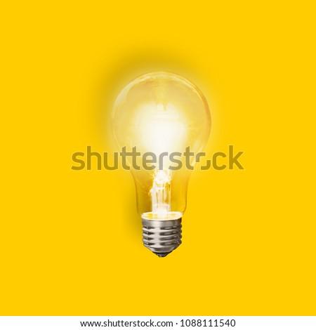 Light bulb on yellow background #1088111540