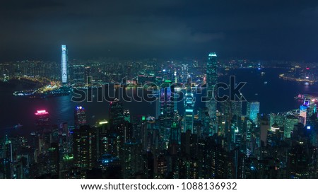 Cyberpunk city Hong Kong at night (skyscraper translation on a side: happy new year) #1088136932