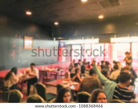Abstract blurred casual Chinese restaurant with traditional noodles, dumplings in Texas, USA. Busy, small place with crowded people dining in #1088368466