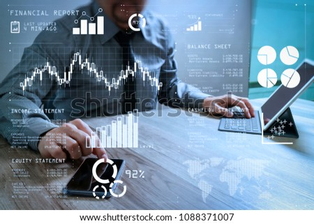 Financial report data of business operations (balance sheet and income statement and diagram) as Fintech concept.businessman using smart phone and keyboard dock digital tablet. #1088371007