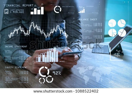 Financial report data of business operations (balance sheet and  income statement and diagram) as Fintech concept.businessman using smart phone and keyboard dock digital tablet. #1088522402