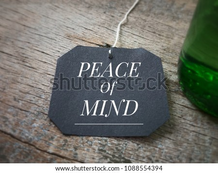 Motivational and inspirational quote - 'Peace of mind' written on a black piece of paper. Vintage styled background. Royalty-Free Stock Photo #1088554394