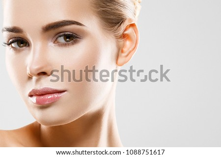 Beauty Woman face Portrait. Beautiful model Girl with Perfect Fresh Clean Skin color lips purple red. Blonde brunette short hair Youth and Skin Care Concept. Isolated on a white background Royalty-Free Stock Photo #1088751617