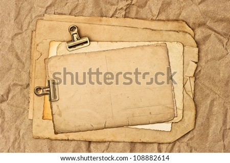 old blank paper, post card and photo sheets with clip. grunge background