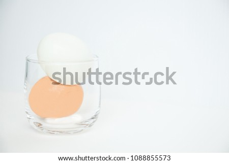 peeled and unpeeled boiled eggs in glass isolated on white background. Organic Food Nutrition. Natural Protein Source, Daily Food Intake, Low Carb Diet, Health Awareness, Intermittent Fasting concept. #1088855573