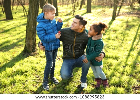 Father and little kids outdoors on sunny day. Child adoption #1088995823