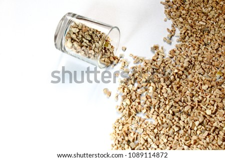 Leave some gravel in a glass on white background #1089114872