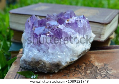Large Amethyst Druze with Goethite Cluster. Premium quality amethyst healing slab that has Deep coloring, dark purple terminations. Large Amethyst sitting on vintage book.  #1089121949