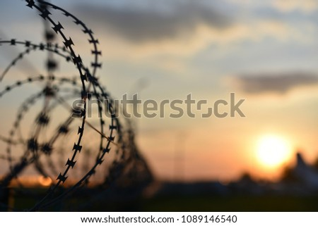 barbed wire of prison fence Royalty-Free Stock Photo #1089146540