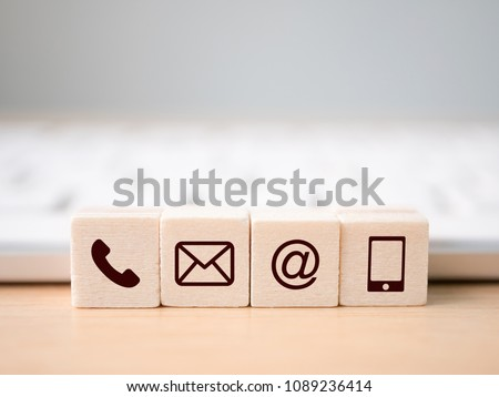 Wood block symbol telephone, mail, address and mobile phone. Website page contact us or e-mail marketing concept #1089236414
