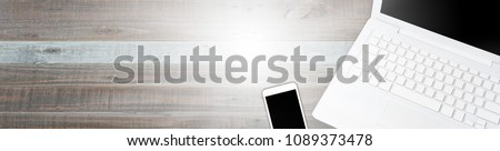 Design of standard horizontal web banners with space for text - Top view Computers and Mobile on wooden table background