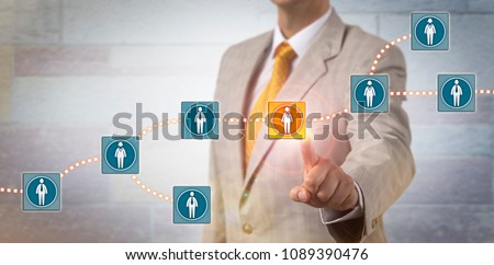Unrecognizable recruitment agent selecting a female candidate data block in a blockchain system. Information technology concept for data management via distributed ledger in a peer to peer network. Royalty-Free Stock Photo #1089390476