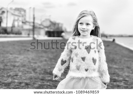 Little happy pretty girl outdoor in the park #1089469859