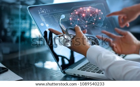 Medicine doctor team meeting and analysis. Diagnose checking brain testing result with modern virtual screen interface on laptop with stethoscope in hand, Medical technology network connection concept #1089540233