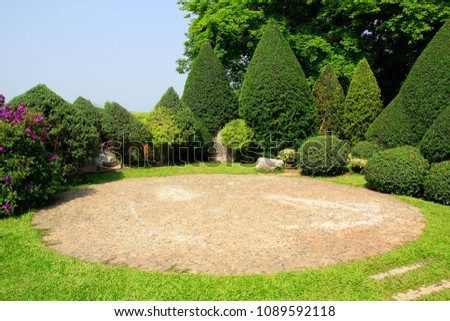 Beautiful trees and green grass garden in summer season.  #1089592118