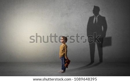 Little boy imagine that he will be businessman and illustrating his future in a big shadow #1089648395