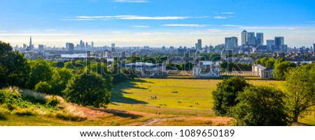 LONDON, UK - JULY 7, 2014: Canary Wharf view from the Greenwich hill. Modern skyscrapers of banking aria. Panorama Cityscape View from Greenwich Greenwich Park. #1089650189