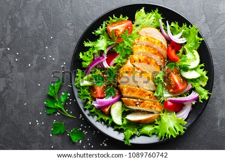 Salad with chicken meat. Fresh vegetable salad with chicken breast. Meat salad with chicken fillet and fresh vegetables on plate #1089760742