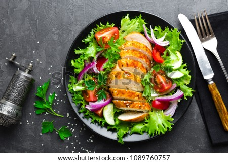 Salad with chicken meat. Fresh vegetable salad with chicken breast. Meat salad with chicken fillet and fresh vegetables on plate #1089760757