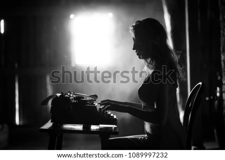 Silhouette of a beautiful girl in a dress on the background of a window in an old house #1089997232