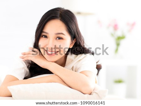 smiling young woman relax on the sofa #1090016141