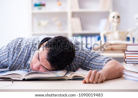 Medical student preparing for exams #1090019483