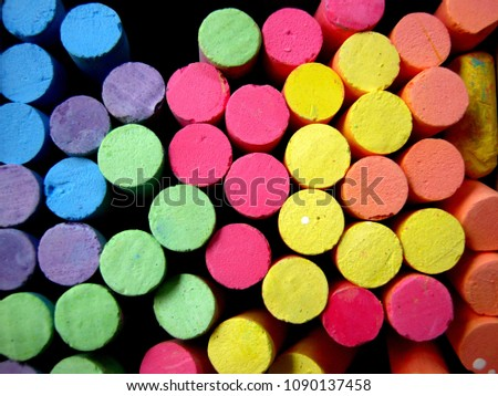pack of colorful chalk waiting for someone use them to write a colorful story of life. #1090137458