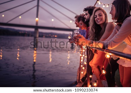 Group of friends relaxing on a boat cruise #1090233074