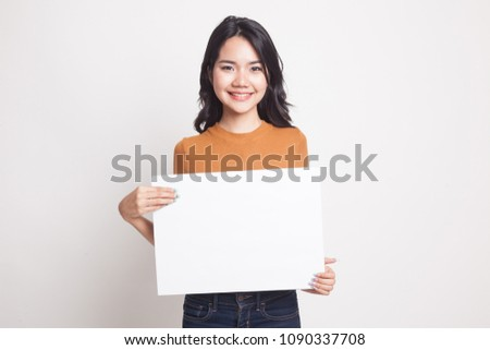 Young Asian woman with white blank sign on white background #1090337708