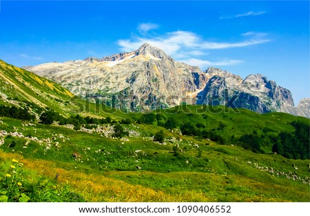 Mountain peak range landscape. Green mountain range view. Mountain peak blue sky white clouds panorama #1090406552