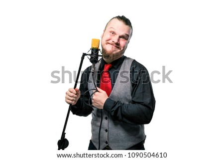 Young handsome businessman singing on stage in microphone #1090504610