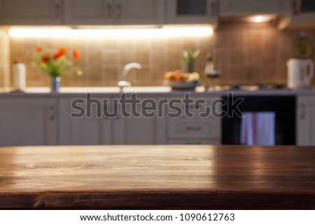 blurred kitchen interior and napkin and desk space #1090612763
