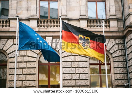 Flag of Germany and the European Union in Berlin. State symbol and national government flag of the Federal Republic of Germany and EU #1090615100
