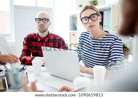 Young businesswoman typing on laptop during a meeting #1090619813
